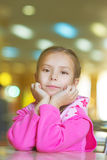 Girl-preschooler sitting at table Stock Photos