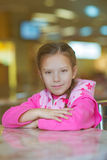 Girl-preschooler sitting at table Stock Image