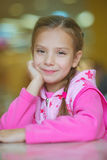 Girl-preschooler sitting at table Royalty Free Stock Image