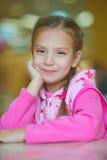 Girl-preschooler sitting at table Royalty Free Stock Image