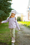 Girl-preschooler walking on curb Royalty Free Stock Photography