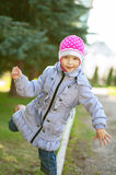 Girl-preschooler walking on curb Royalty Free Stock Photo