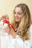 The girl with the present Royalty Free Stock Images