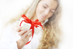 The girl with the present Stock Image
