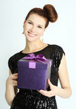 Girl with the present Stock Photography