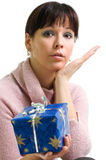 Girl with present. Young brunette with blue Christmas present isolated over white Royalty Free Stock Photography