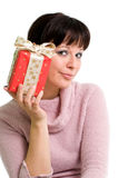 Girl with present. Young brunette holding red present, isolated over white Stock Photos