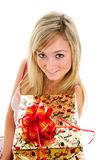 Girl with a present Stock Images