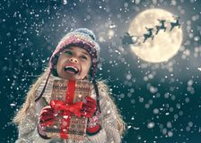 Girl with present at Christmas royalty free stock photography