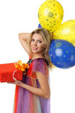 Girl with present and colourful balloons Stock Photography