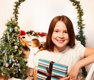 Girl with present for New year Stock Photo