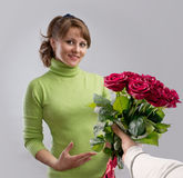 Girl presented with a bouquet of flowers Royalty Free Stock Image
