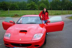 Girl presenting Ferrari Stock Photos