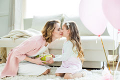 Girl presenting gift to mother Royalty Free Stock Photo