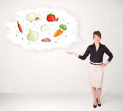 Girl presenting nutritional cloud with vegetables Royalty Free Stock Photos