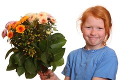 Girl presenting some flowers. Portrait of a young girl holding a bunch of flowers Royalty Free Stock Photography