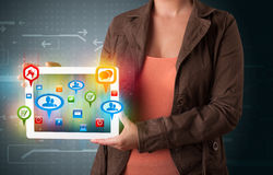 Girl presenting a tablet with colorful social icons and signs. Young girl presenting a tablet with colorful social icons and signs stock illustration