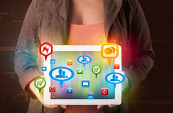 Girl presenting a tablet with colorful social icons and signs. Young girl presenting a tablet with colorful social icons and signs vector illustration