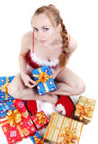 Girl with presents. Beautiful girl in red dress with christmas presents Royalty Free Stock Image