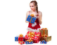 Girl with presents. Beautiful girl in red dress with christmas presents Royalty Free Stock Images