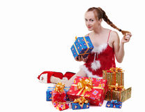 Girl with presents. Beautiful girl in red dress with christmas presents Stock Images