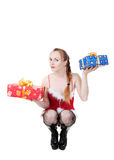 Girl with presents. Beautiful girl in red dress with christmas presents Royalty Free Stock Photography