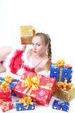 Girl with presents. Beautiful girl in red dress with christmas presents Royalty Free Stock Photo