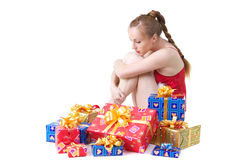 Girl with presents. Beautiful girl in red dress with christmas presents Stock Image