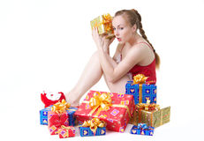 Girl with presents. Beautiful girl in red dress with christmas presents Stock Photos
