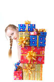Girl with presents. Beautiful girl in red dress with christmas presents Stock Photography