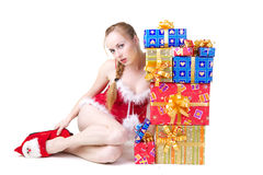 Girl with presents. Beautiful girl in red dress with christmas presents Royalty Free Stock Photos