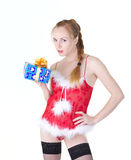 Girl with presents. Beautiful girl in red dress with christmas presents Stock Photo
