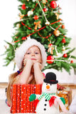 Girl  beside presents Stock Photos