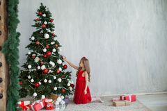 Girl with presents new year Christmas tree on a grey background gifts stock images