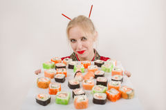 Girl presents sushi Royalty Free Stock Photo