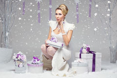 Girl with preset boxes Stock Photography
