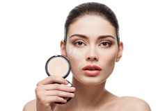 Girl with pressed powder in hand Stock Photo