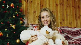 The girl presses to a lot of toy bears stock video footage