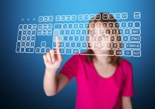 Girl pressing enter on virtual keyboard Royalty Free Stock Images