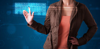 Girl pressing virtual type of keyboard. Young girl pressing virtual type of keyboard Royalty Free Stock Photography