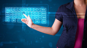 Girl pressing virtual type of keyboard. Young girl pressing virtual type of keyboard Royalty Free Stock Image