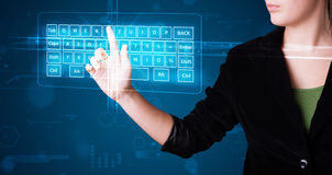 Girl pressing virtual type of keyboard Royalty Free Stock Photography