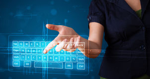 Girl pressing virtual type of keyboard Stock Photos