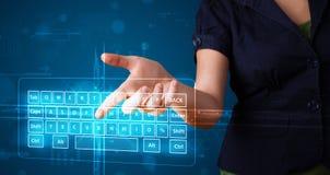 Girl pressing virtual type of keyboard. Young girl pressing virtual type of keyboard Stock Photos