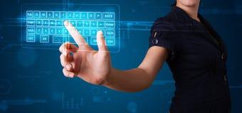 Girl pressing virtual type of keyboard. Young girl pressing virtual type of keyboard Stock Photo