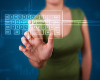 Girl pressing virtual type of keyboard Royalty Free Stock Photo