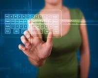 Girl pressing virtual type of keyboard. Young girl pressing virtual type of keyboard Royalty Free Stock Photo
