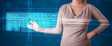 Girl pressing virtual type of keyboard Stock Photos
