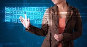 Girl pressing virtual type of keyboard. Young girl pressing virtual type of keyboard Royalty Free Stock Photos
