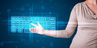 Girl pressing virtual type of keyboard. Young girl pressing virtual type of keyboard Royalty Free Stock Images